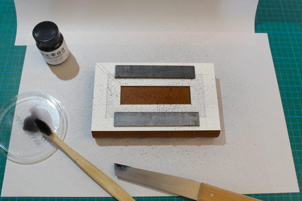 Sprinkling iron-gall ink